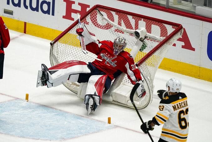 Washington Capitals goaltender Craig Anderson (31) falls into the net during the first period of Game 1 of the team's NHL hockey Stanley Cup first-round playoff series against the Boston Bruins, Saturday, May 15, 2021, in Washington. (AP Photo/Alex Brandon)