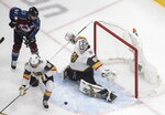 Colorado Avalanche's Gabriel Landeskog (92) and Vegas Golden Knights' Zach Whitecloud (2) look for the rebound on the save from goalie Robin Lehner (90) during the second period of an NHL Stanley Cup hockey qualifying round game in Edmonton, Alberta, Saturday, Aug. 8, 2020.(Jason Franson/The Canadian Press via AP)