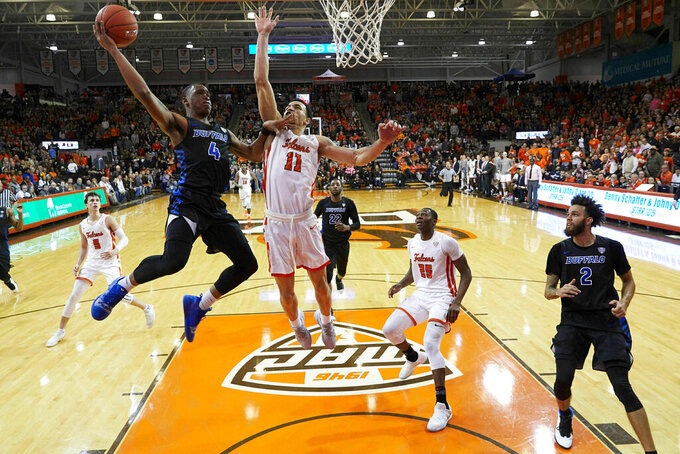 Buffalo guard Davonta Jordan (4) goes to the basket on Bowling Green guard Antwon Lillard (11) in the second half of an NCAA college basketball game in Bowling Green, Ohio, Friday, Feb. 01, 2019.  (AP Photo/Rick Osentoski)