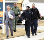 Charleston Mayor John Tecklenburg, left, and interim Police Chief Jerome Taylor make their way to a news conference on the search for Heidi Todd on Wednesday, Feb. 14, 2018, in Charleston, S.C. The 4-year-old went missing Tuesday on Johns Island. (Brad Nettles/The Post And Courier via AP)