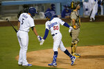 Los Angeles Dodgers' Mookie Betts, center, celebrates his second home run of a baseball game with Corey Seager as San Diego Padres catcher Austin Hedges looks away during the fourth inning Thursday, Aug. 13, 2020, in Los Angeles. (AP Photo/Jae C. Hong)