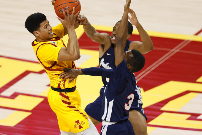 Iowa State guard Rasir Bolton, left, fights to get off a pass as he is swarmed by Jackson State forward Demarion Bariffe-Smith, center, and guard Jonas James, right, during the first half of an NCAA college basketball game, Sunday, Dec. 20, 2020, in Ames, Iowa. (AP Photo/Matthew Putney)