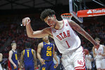 Utah forward Timmy Allen (1) celebrates after scoring against California during the second half of an NCAA college basketball game Saturday, Feb. 8, 2020, in Salt Lake City. (AP Photo/Rick Bowmer)