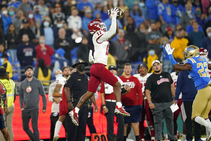 Fresno State wide receiver Josh Kelly (11) makes a catch against UCLA during the second half of an NCAA college football game Sunday, Sept. 19, 2021, in Pasadena, Calif. (AP Photo/Marcio Jose Sanchez)