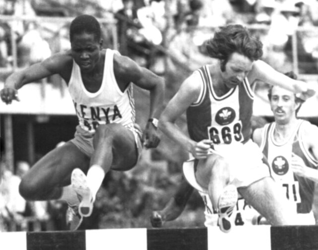 FILE  - In this Jan. 26, 1974 file photo, Ben Jipcho of Kenya, left and John Davies of Wales take a hurdle during the Steeplechase Final at the Tenth Commonwealth Games, in Christchurch, New Zealand which Jipcho won. Jipcho has died at the age off 77, it was reported on Friday, July 24, 2020.  Jipcho was famous for being the runner who sacrificed his own hopes of a medal to help teammate Kip Keino beat American and heavy favorite Jim Ryun to the gold medal in the 1,500 meters at the 1968 Mexico City Olympics. (AP Photo, File)