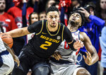 Missouri's K.J. Santos (2) is called for charging foul against Mississippi guard Blake Hinson (0) ) during an NCAA college basketball game in Oxford, Miss., Saturday, Feb. 16, 2019. (Bruce Newman/The Oxford Eagle via AP)