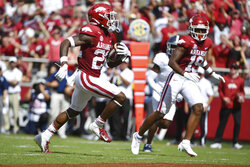 Arkansas running back Trelon Smith (22) runs for a touchdown against Georgia Southern during the first half of an NCAA college football game Saturday, Sept. 18, 2021, in Fayetteville, Ark. (AP Photo/Michael Woods)