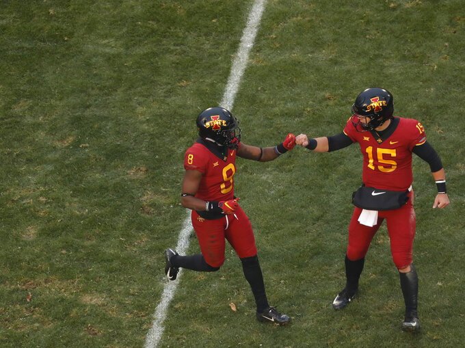 Iowa State wide receiver Deshaunte Jones, left, and quarterback Brock Purdy, right, celebrate a touchdown during the first half of an NCAA college football game against Baylor, Saturday, Nov. 10, 2018, in Ames, Iowa. (AP Photo/Matthew Putney)