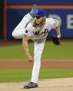 New York Mets pitcher Noah Syndergaard watches a throw to a Toronto Blue Jays batter during the first inning of a baseball game Tuesday, May 15, 2018, in New York. (AP Photo/Julie Jacobson)