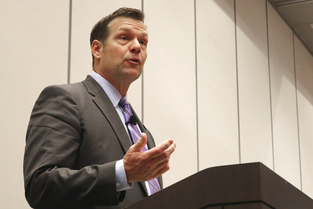 FILE - In this Feb. 1, 2020, file photo, U.S. Senate candidate and former Kansas Secretary of State Kris Kobach, answers a question during a debate in Olathe, Kan. Kobach says he had four guns stolen from his pickup truck that was parked at a Kansas hotel June 13, 2020, in Wichita, Kan. Wichita police say officers responded to a call from Kobach around 11:30 a.m. Saturday at a hotel parking garage. Police say someone broke into the pickup overnight and took a rifle, two shotguns and a handgun. (AP Photo/John Hanna File)
