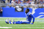 Detroit Lions cornerback Jeff Okudah sits on the field after being injured against the San Francisco 49ers in the second half of an NFL football game in Detroit, Sunday, Sept. 12, 2021. Okudah suffered a season-ending Achilles tendon injury. (AP Photo/Lon Horwedel)