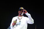"FILE - In this Jan. 5, 2019 file photo, Snoop Dogg performs onstage at State Farm Arena in Atlanta. The University of Kansas has apologized for its risque Late Night at the Phog event in which the rapper performed, stripper poles were wheeled onto the Allen Fieldhouse floor and fake money was shot over the heads of prospective recruits. Athletic director Jeff Long said Friday, Oct. 4  ""we expected a clean version of the show."" Long said in a statement the school fell short of providing a ""family atmosphere"" during the annual kickoff for the school's beloved basketball program. (Photo by Paul R. Giunta/Invision/AP, File)"