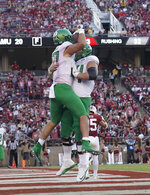 Oregon tight end Jacob Breeland (27) celebrates with teammate lineman Calvin Throckmorton (54) after scoring a touchdown against Stanford during the second half of an NCAA college football game on Saturday, Sept. 21, 2019, in Stanford, Calif. (AP Photo/Tony Avelar)