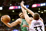 Boston Celtics forward Jayson Tatum (0) commits an offensive foul against Toronto Raptors center Marc Gasol (33) during first half NBA basketball action in Toronto on Tuesday, Feb. 26, 2019. (Frank Gunn/The Canadian Press via AP)