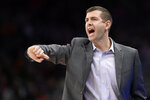 FILE - In this Jan. 6, 2020 file photo, Boston Celtics head coach Brad Stevens gestures during the second half of an NBA basketball game against the Washington Wizards in Washington. Before the pandemic forced the NBA to pause its season, the Celtics were a team eager to figure out what they could be. That question still lingers as Boston prepares to restart the now-truncated season inside the Orlando bubble. (AP Photo/Nick Wass, File)
