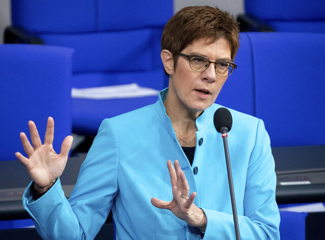 German Defence Minister Annegret Kramp-Karrenbauer speaks during a questioning of the Federal Government as part of a meeting of the German federal parliament, Bundestag, at the Reichstag building in Berlin, Germany, Wednesday, Nov. 25, 2020. On Wednesday Germany's Cabinet has approved legislation that would provide compensation to gay servicepeople who experienced discrimination in the military until a change of policy in 2000. (Kay Nietfeld/dpa via AP)