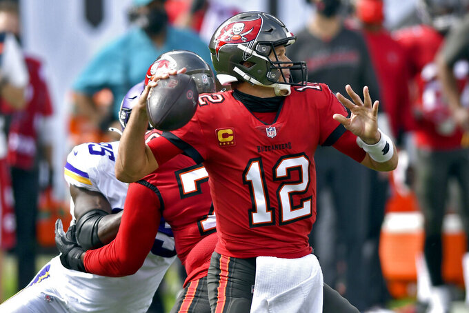 Tampa Bay Buccaneers quarterback Tom Brady (12) throws a pass against the Minnesota Vikings during the first half of an NFL football game Sunday, Dec. 13, 2020, in Tampa, Fla. (AP Photo/Jason Behnken)