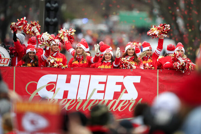 Kansas City Chiefs cheerleaders ride a float during the Super Bowl parade in Kansas City, Mo., Wednesday, Feb. 5, 2020. (AP Photo/Orlin Wagner)