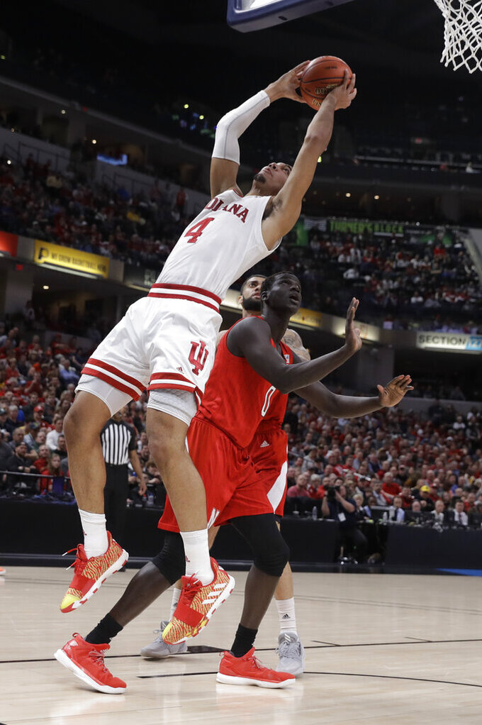 Indiana's Trayce Jackson-Davis (4) puts up a shot against Nebraska's Akol Arop (0) during the first half of an NCAA college basketball game at the Big Ten Conference tournament, Wednesday, March 11, 2020, in Indianapolis. (AP Photo/Darron Cummings)