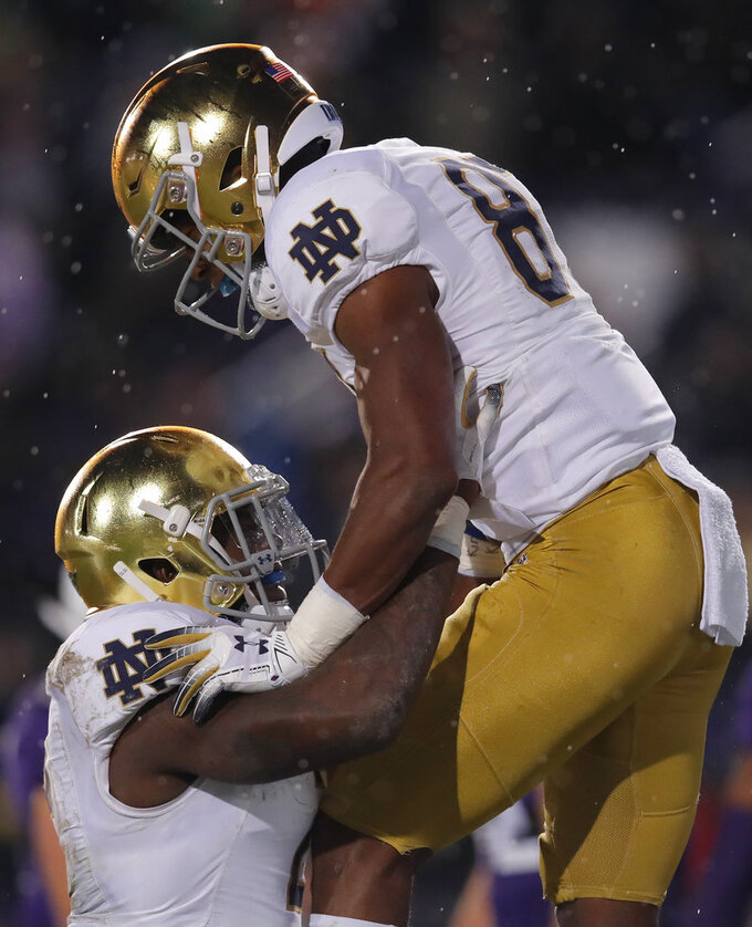 Notre Dame's Michael Young, right, celebrates his touchdown against Northwestern with Notre Dame's Dexter Williams during the second half of an NCAA college football game Saturday, Nov. 3, 2018, in Evanston, Ill. (AP Photo/Jim Young)