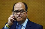 Venezuela's Deputy Julio Borges talks on his cellphone as he attends a session of the 49th OAS General Assembly in Medellin, Colombia, Thursday, June 27, 2019. The Organization of American States holds the second day of its three-day General Assembly meeting in Medellin, Colombia, where the crisis in Venezuela is the focus.(AP Photo/Luis Benavides)