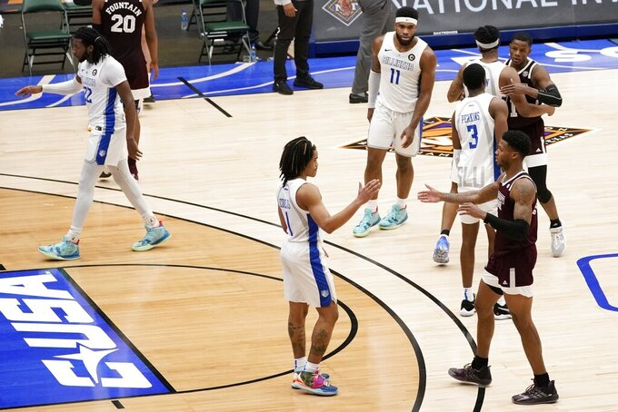 Saint Louis and Mississippi State players greet each other after their NCAA college basketball game in the first round of the NIT Tournament, Saturday, March 20, 2021, in Frisco, Texas. Mississippi State won. (AP Photo/Tony Gutierrez)
