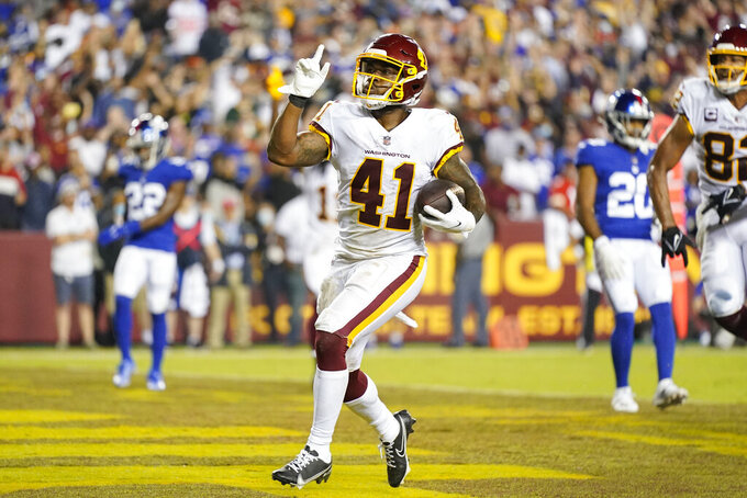 Washington Football Team running back J.D. McKissic (41) gesturing as he scores a touchdown against the New York Giants during the first half of an NFL football game, Thursday, Sept. 16, 2021, in Landover, Md. (AP Photo/Patrick Semansky)
