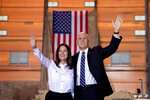 Vice President Mike Pence and his wife Karen Pence wave as they take the stage to speak to troops at Al Asad Air Base, Iraq, Saturday, Nov. 23, 2019. The visit is Pence's first to Iraq and comes nearly one year since President Donald Trump's surprise visit to the country. (AP Photo/Andrew Harnik)
