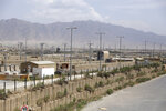 """Blast wallls and a few buildings can be seen at the Bagram air base after the American military left the base, in Parwan province north of Kabul, Afghanistan, Monday, July 5, 2021. The U.S. left Afghanistan's Bagram Airfield after nearly 20 years, winding up its """"forever war,"""" in the night, without notifying the new Afghan commander until more than two hours after they slipped away. (AP Photo/Rahmat Gul)"""