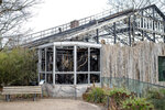 Exterior view of the destroyed ape house of the Zoo in Krefeld, Germany, Thursday, Jan. 2, 2020. Three woman are under investigation for launching paper sky lanterns blamed for setting off a fire that destroyed an ape house at the zoo in the first few minutes of the new year, killing more than 30 animals, officials said Thursday. (Marcel Kusch/dpa via AP)