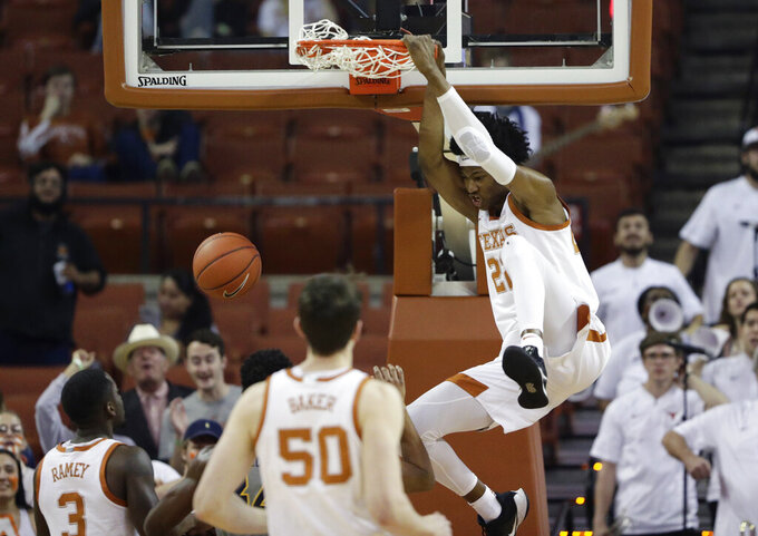 Texas forward Kai Jones (22) scores against West Virginia during the first half of an NCAA college basketball game, Monday, Feb. 24, 2020, in Austin, Texas. (AP Photo/Eric Gay)