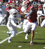 Arkansas kick returner Deon Stewart, right, tries to get past Tulsa defender Brandon Johnson as he returns a kick in the first half of an NCAA college football game Saturday, Oct. 20, 2018, in Fayetteville, Ark. (AP Photo/Michael Woods)