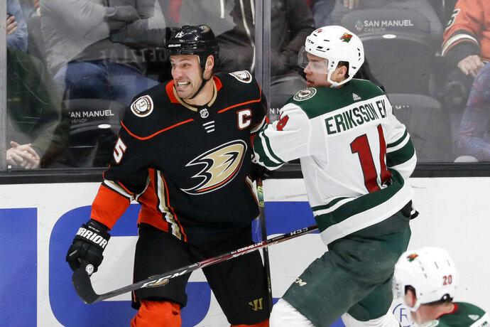 Minnesota Wild center Joel Eriksson Ek, right, checks Anaheim Ducks center Ryan Getzlaf during the third period of an NHL hockey game in Anaheim, Calif., Tuesday, Nov. 5, 2019. (AP Photo/Chris Carlson)