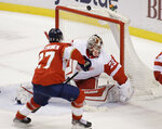 Detroit Red Wings goaltender Thomas Greiss (29) guards the goal against Florida Panthers center Eetu Luostarinen (27) during the second period of an NHL hockey game on Tuesday, March 30, 2021, in Sunrise, Fla. (AP Photo/Terry Renna)