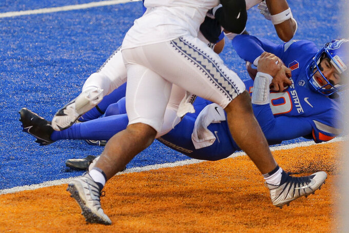 Boise State quarterback Hank Bachmeier (19) dives into the end zone on a 6 yard touchdown run against Utah State in the first half of an NCAA college football game Saturday, Oct. 24, 2020, in Boise, Idaho. Boise State won 42-13. (AP Photo/Steve Conner)