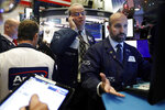 Specialist James Denaro, right, and trader David O'Day, center, work on the floor of the New York Stock Exchange, Wednesday, Dec. 4, 2019. Stocks are opening broadly higher as traders became more hopeful that a trade deal between the U.S. and China was making progress. (AP Photo/Richard Drew)