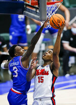 Mississippi guard Luis Rodriguez (15) shoots as Louisiana Tech guard Amorie Archibald (3) defends during the first half of an NCAA college basketball game in the NIT, Friday, March 19, 2021, in Frisco, Texas. (AP Photo/Brandon Wade)