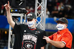 Georgia place kicker Jack Podlesny, offensive player of the game, stands with Georgia head coach Kirby Smart after the Peach Bowl NCAA college football game against Cincinnati, Friday, Jan. 1, 2021, in Atlanta. Georgia won 22-21. (AP Photo/Brynn Anderson)