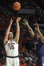 Illinois' Giorgi Bezhanishvili (15) shoots over Northwestern's Jared Jones (4) in the first half of an NCAA college basketball game, Saturday Jan. 18, 2020, in Champaign, Ill. (AP Photo/Holly Hart)