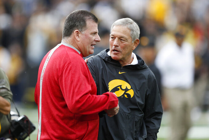 Miami of Ohio coach Chuck Martin, left, talks with Iowa coach Kirk Ferentz before an NCAA college football game Saturday, Aug. 31, 2019, in Iowa City, Iowa. (AP Photo/Charlie Neibergall)