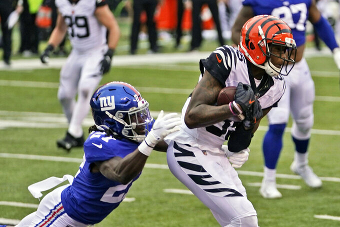 Cincinnati Bengals wide receiver Tee Higgins (85) catches a 1-yard pass for a touchdown during the second half of an NFL football game against the New York Giants, Sunday, Nov. 29, 2020, in Cincinnati. (AP Photo/Bryan Woolston)