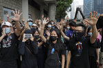 Supporters of Hong Kong activist Edward Leung, hold up their hands to represent the protesters' five demands outside the High Court in Hong Kong, Wednesday, Oct. 9, 2019. Last year, Leung was sentenced to six years in prison for his part in a violent nightlong clash with police over illegal street food hawkers two years ago. (AP Photo/Kin Cheung)