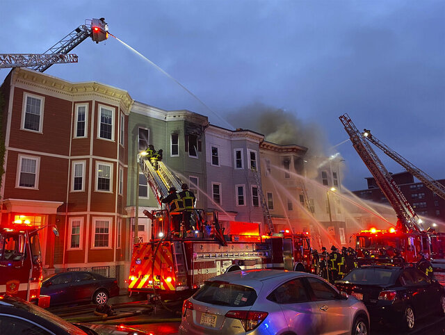 Boston firefighters battle a blaze in South Boston early Saturday, May 30, 2020.    The seven-alarm fire started around 3:30 a.m., the Boston Fire Department said.  (Boston Fire Dept. via AP)