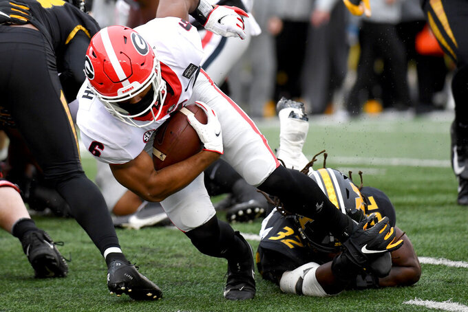 Georgia running back Kenny McIntosh (6) is pulled down by Missouri linebacker Nick Bolton (32) during the first half of an NCAA college football game Saturday, Dec. 12, 2020, in Columbia, Mo. (AP Photo/L.G. Patterson)