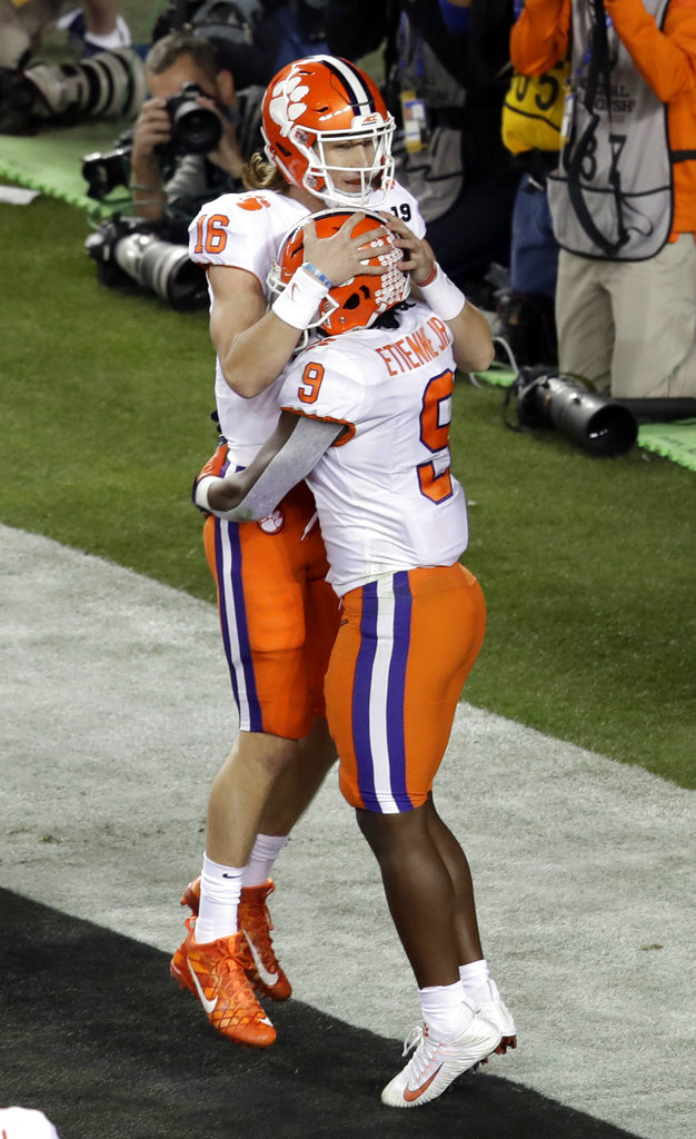 Clemson's Travis Etienne (9) celebrates his touchdown run with Trevor Lawrence (16) during the first half the NCAA college football playoff championship game against Alabama, Monday, Jan. 7, 2019, in Santa Clara, Calif. (AP Photo/Jeff Chiu)