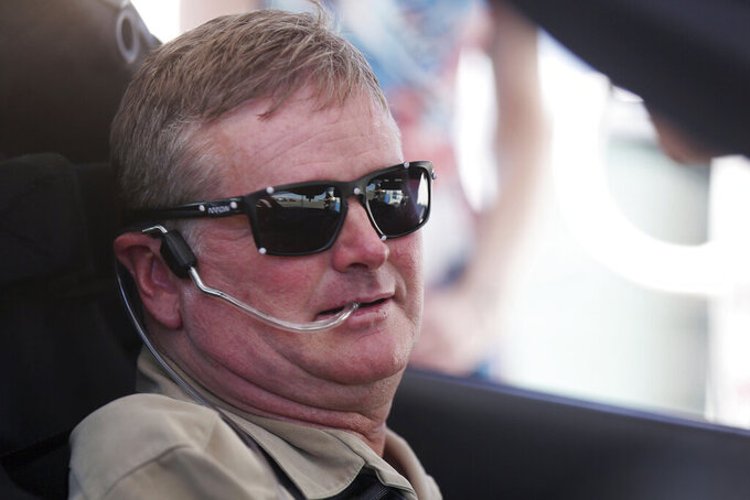 FILE - In this Sept. 27, 2016, file photo, Sam Schmidt prepares to drive his modified Corvette in Las Vegas. McLaren will return to full-time IndyCar competition next season for the first time since 1979 in a partnership with existing team Arrow Schmidt Peterson Motorsports. Arrow Electronics will remain the team's title partner and team co-founders Sam Schmidt and Ric Peterson will continue in their current leadership roles. (AP Photo/Isaac Brekken, File)
