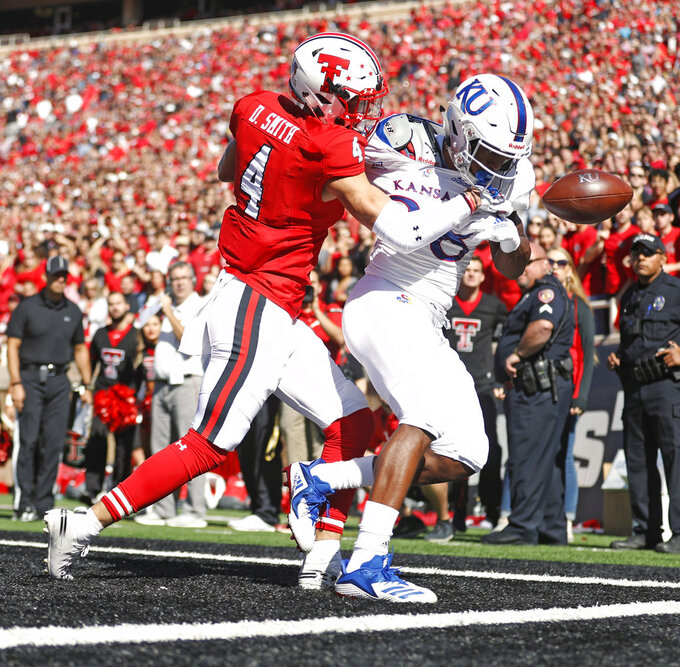 Texas Tech's Desmon Smith (4) breaks up a pass intended for Kansas' Jeremiah Booker (88) during the first half of an NCAA college football game Saturday, Oct. 20, 2018, in Lubbock, Texas. (Brad Tollefson/Lubbock Avalanche-Journal via AP)
