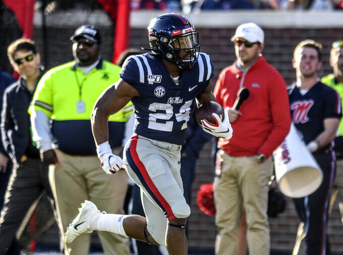 Mississippi running back Snoop Conner (24) runs for a touchdown against New Mexico State during an NCAA college football game in Oxford, Miss., Saturday, Nov. 9, 2019. (Bruce Newman/The Oxford Eagle via AP)