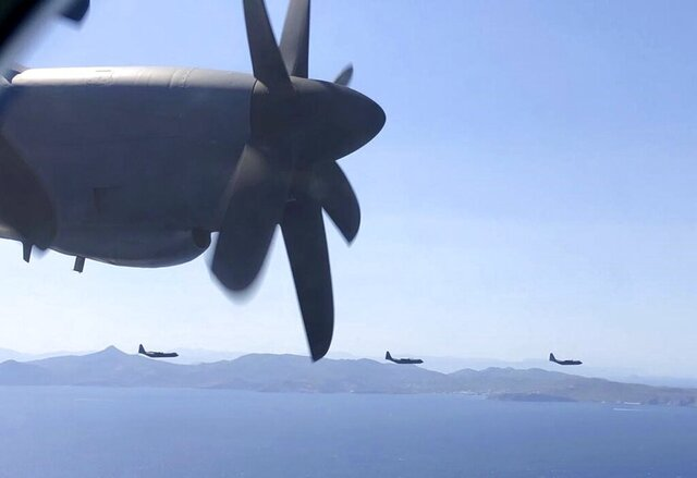 In this photo provided by the Greek Defense Ministry, military planes take part in a Greek-US military exercise near Athens, on Friday, Sept. 11, 2020. Prime Minister Kyriakos Mitsotakis was to outline the details of a program Saturday to boost Greece's defense capabilities, amid heightened tensions with neighboring Turkey over rights to resources in the eastern Mediterranean. (Greek Defense Ministry via AP)