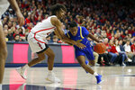 South Dakota State guard Brandon Key, right, is fouled by Arizona forward Zeke Nnaji in the first half during an NCAA college basketball game, Thursday, Nov. 21, 2019, in Tucson, Ariz. (AP Photo/Rick Scuteri)